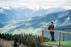 Observation deck on lookout, viewpoint in Alps mountains, Switzerland. Man - stock photo
