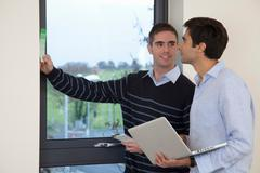 Two developers in their new apartment - stock photo