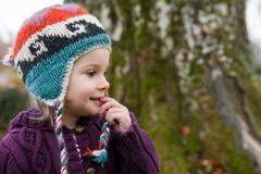 Little girl in knitted sweater and cap Stock Photos