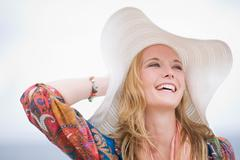 Girl with floppy hat - stock photo
