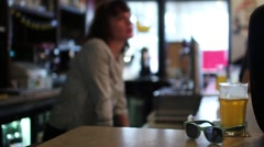 Female Bartender Behind Bar Counter Talking To Clients Stock Footage