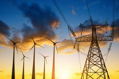 High voltage tower and wind turbines Stock Photos