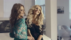 Glamour  shot of two fashion models in long evening dresses in the showroom - stock footage
