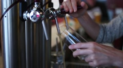 Female Bartender Pouring Half Pint Of Beer - stock footage