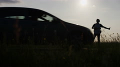 4K Silhouette of a hitchhiker getting ignored by passing vehicles, in slow motio Stock Footage