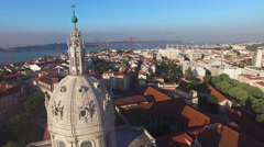 Dome of the Estrela Basilica on a background of Lisbon at morning aerial view Stock Footage