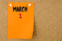 1 MARCH written on orange paper note - stock photo