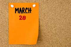 28 MARCH written on orange paper note Stock Photos
