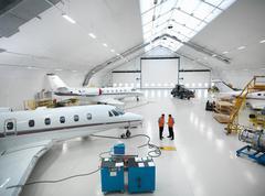 Engineers in jet aircraft hangar Stock Photos