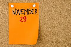 29 NOVEMBER written on orange paper note - stock photo