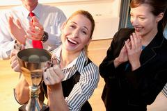Happy colleague receives prize - stock photo