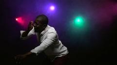 African American man dancing, making rhythmic movements. Slow motion - stock footage