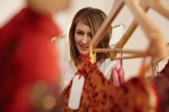 Young lady fascinated in fashion store Stock Photos