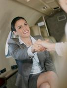 Contended businesswoman - stock photo