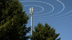 A mobile or cell phone mast transmitting radio waves. Stock Footage