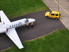 Engineers inspect jet on runway Stock Photos
