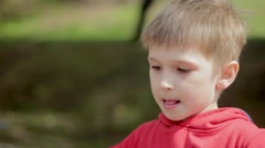 Boy on merry-go-round in park. Carousel. Slowmotion - stock footage