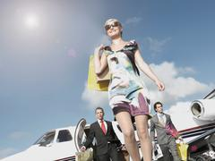 Rich woman traveling in private jet Stock Photos