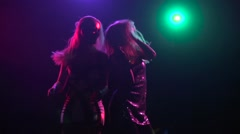 Close-up of female silhouette dancing back to back. Slow motion - stock footage