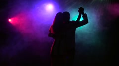 Silhouette of dancing couple in disco style. Close-up. Slow motion - stock footage