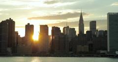 New York City Manhattan buildings skyline evening sunset manhattanhenge Stock Footage