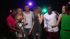 Close-up friends of different nationalities dancing at party. Slow motion Stock Footage