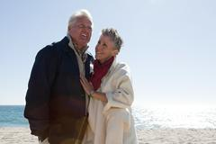 Mature couple by the sea Stock Photos