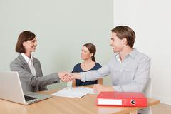 Young couple with financial adviser - stock photo
