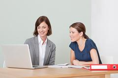 Young woman with financial adviser - stock photo