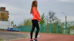 stylish sexy sporty girl in sportswear - stock footage