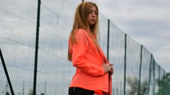 girl sportswoman removes his jacket on video - stock footage