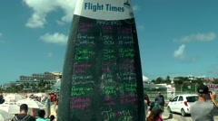 Departure and arrival flight list on Maho beach, St.Marteen Stock Footage
