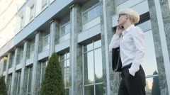 Business Woman Making a Phone Call Outside Business Center - stock footage