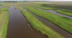 Eel fisher in a boat in the wetlands in the Netherland filmed with a drone - stock footage