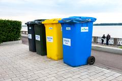 Colourful dumpsters on a city embankment of Volga river in summer day - stock photo