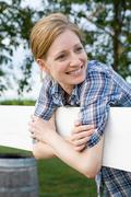 Cheerful woman in paddock Stock Photos
