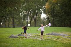 Girls at birthday party holding balloons Stock Photos