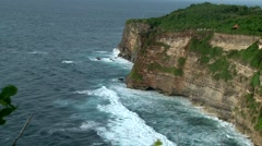 BALI. INDONESIA: ocean waves crush on rocks, Uluwatu, long shoot - stock footage