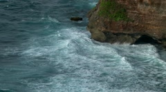 BALI. INDONESIA: sea waves crush on rocks, Uluwatu - stock footage
