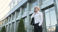 Business Woman Making a Phone Call Outside Business Center Stock Footage