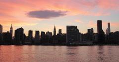 New York City Manhattan buildings skyline evening sunset orange sky Stock Footage