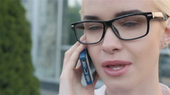 Portrait of Business Woman Making a Phone Call Outside Business Center - stock footage