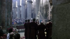 SANTIAGO DE COMPOSTELA - Priests stopping the incence burner Stock Footage