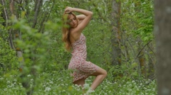 girl posing on a background of the spring forest - stock footage
