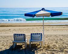 Sunlounger and parasol on beach, Benidorm, Costa Blanca, Spain - stock photo