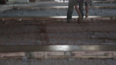 Construction worker placing metal grid Stock Footage