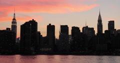 New York City Manhattan buildings skyline evening sunset orange sky - stock footage