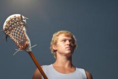 Lacrosse player with lacrosse stick Kuvituskuvat