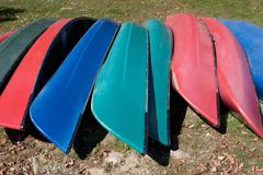 Canoes upside down in a row Stock Photos
