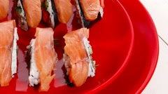 Japanese cuisine onigiri sashimi inside out sushi rolls Stock Footage
